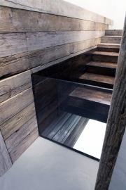 """Andrea Santarlasci""""Sotto di noi, immobile, scende il tempo dell'acqua"""", 2015. DettaglioInstallazione, legno, vetro, resina, ferro, specchio e acqua, 135 x 464 x 82 cm"""