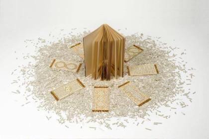Sabrina Mezzaqui, E disse, 2014. Libro intagliato (Erri De Luca, E disse, ed. Feltrinelli), migliaia di ritagli  di carta stampata, ricamo, perline, colla, dimensioni variabili (libro h. 19,5 cm)   Foto Rino Canobbi
